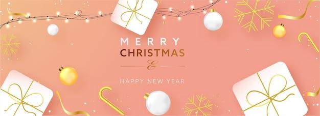 Texto de feliz natal e feliz ano novo com enfeites realistas