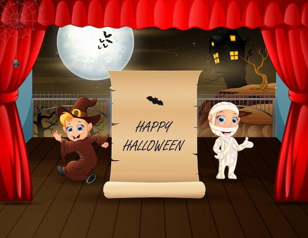 Texto de halloween com múmia e bruxa no palco