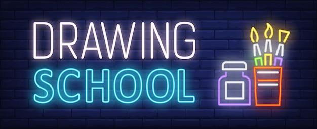 Texto de néon de escola de desenho com o conjunto de escovas e garrafa