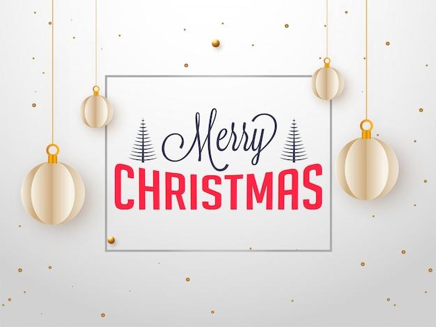 Texto elegante de feliz natal e enfeites de papel cortado no cartão branco de suspensão.