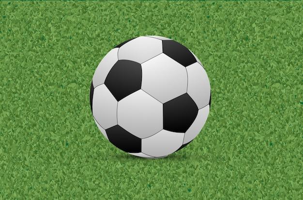 Textura de grama verde com bola de futebol