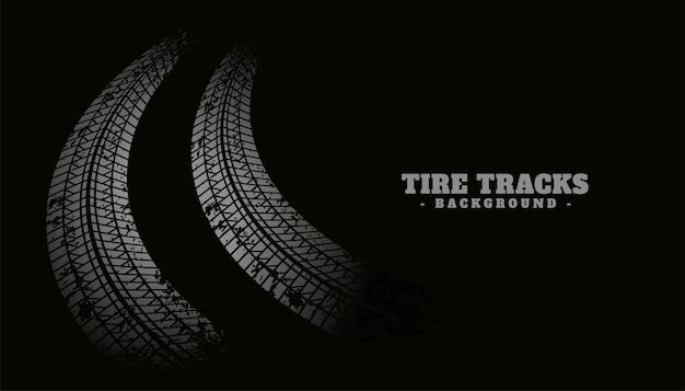 Textura de impressão da trilha do pneu em fundo preto