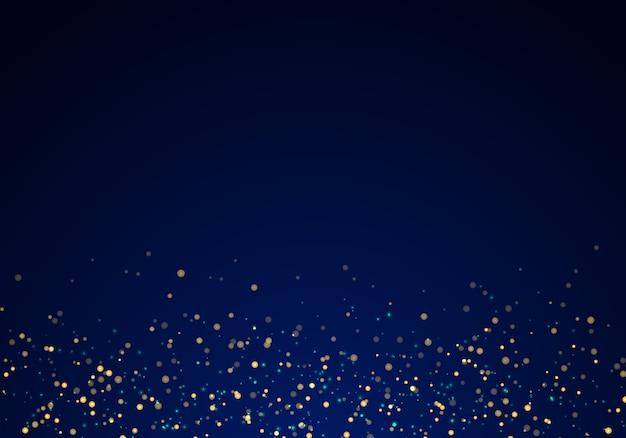 Textura de luzes de glitter dourado caindo sobre fundo azul