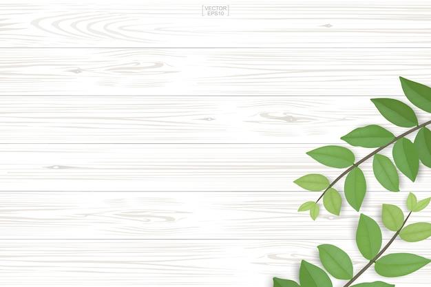 Textura de madeira com folhas verdes.