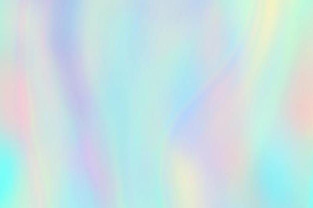 Textura do arco-íris. fundo iridescente de folha de holograma. padrão de unicórnio fantasia pastel