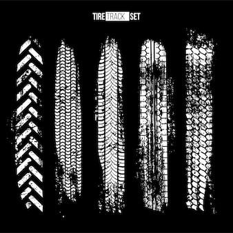 Texturas de pista de pneu brancas definidas em fundo preto
