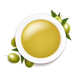 Tigela de cerâmica branca com azeite e galho com azeitonas verdes sobre fundo branco com malha gradiente