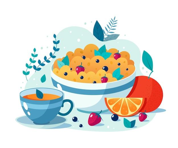 Tigela de mingau de aveia com morangos e mirtilos e uma xícara de chá verde