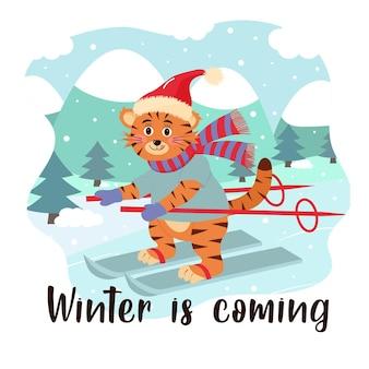 Tigre fofo com chapéu e lenço esquiando paisagem de inverno letras de inverno chegando