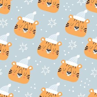 Tigre fofo e flocos de neve de inverno sem costura padrão em fundo azul claro