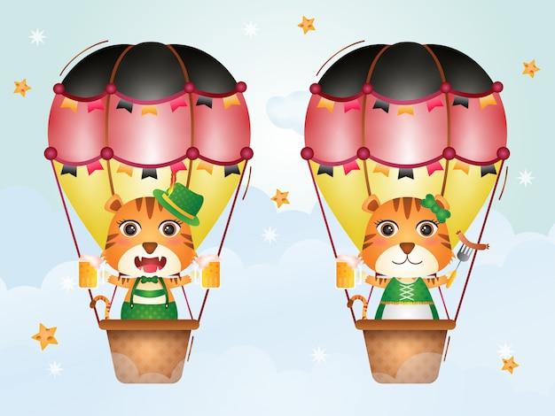 Tigre fofo no balão de ar quente com o vestido tradicional da oktoberfest