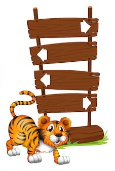 Tigre na frente de uma tabuleta de madeira