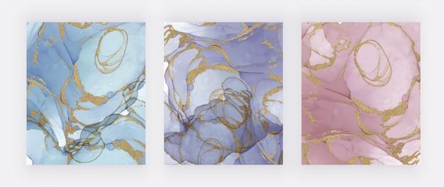 Tinta abstrata azul, roxa e rosa com textura de glitter dourados. mão abstrata pintada em aquarela fundos.