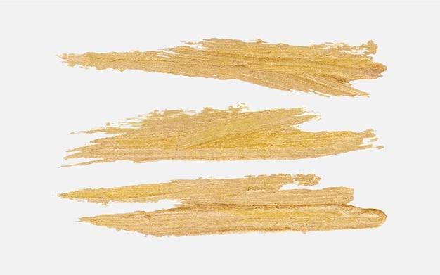 Tinta pincelada dourada feita à mão