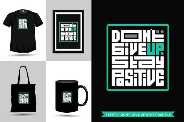 Tipografia da moda cite motivação camiseta não desista de ficar positivo para imprimir. modelo de tipografia vertical para mercadoria