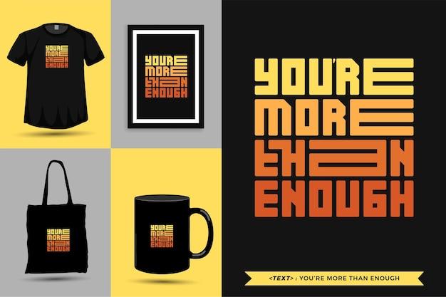Tipografia moderna cite a motivação camiseta você é mais do que suficiente para imprimir. letras tipográficas pôster, caneca, sacola, roupas e mercadorias com modelo de design vertical