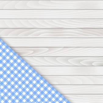 Toalha de mesa de canto azul na mesa de madeira branca