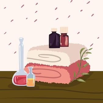 Toalhas e garrafas de spa