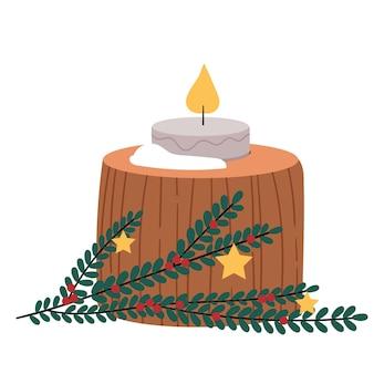 Toco de floresta de inverno com uma vela