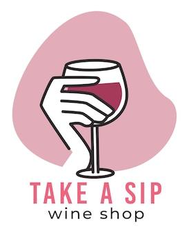 Tome um gole do emblema da loja de vinhos com o copo na mão