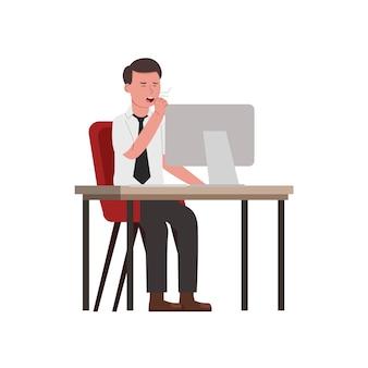 Trabalhador bocejando cansado e exausto enquanto trabalhava em frente ao computador
