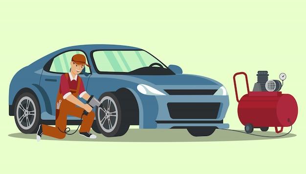 Trabalhador com bomba elétrica na mão sacode a roda. mude a roda no carro. estação de serviço. auto-serviço