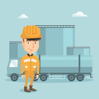 Trabalhador com caminhão de combustível e planta de óleo.