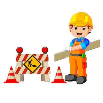 Trabalhador com sinal de construção