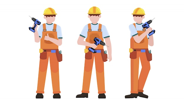 Trabalhador da construção civil segurando o conjunto de caracteres de furadeira elétrica