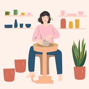 Trabalhador de cerâmica mulher. trabalhando com roda de cerâmica. caneca de artesanato, placa. conceito de criatividade em casa.
