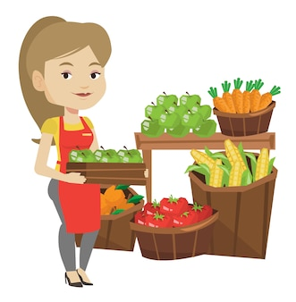 Trabalhador de supermercado com caixa cheia de maçãs.