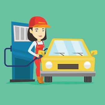 Trabalhador, encher combustível no carro no posto de gasolina