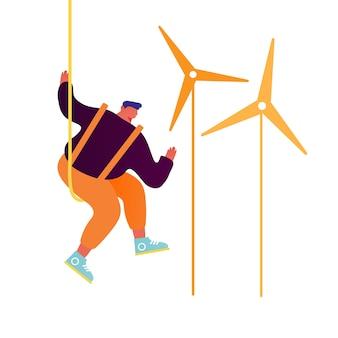 Trabalhador fazendo manutenção de moinhos de vento