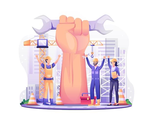 Trabalhadores da construção civil com o braço gigante levantado comemoram o dia do trabalho em 1 de maio.