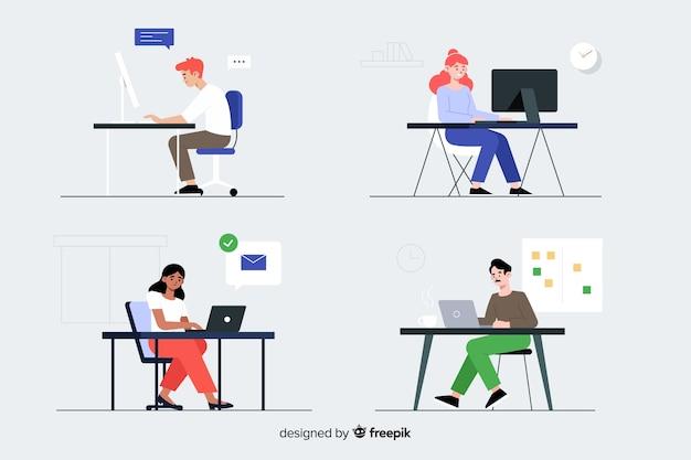 Trabalhadores de escritório sentado no conjunto de mesas