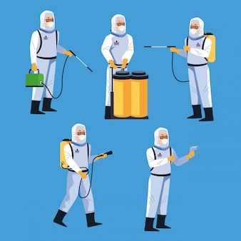Trabalhadores em biossegurança com desinfecção de equipamentos