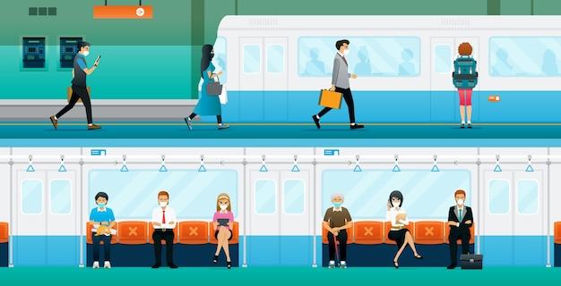 Trabalhadores mantêm distâncias sociais e usam máscaras no metrô.