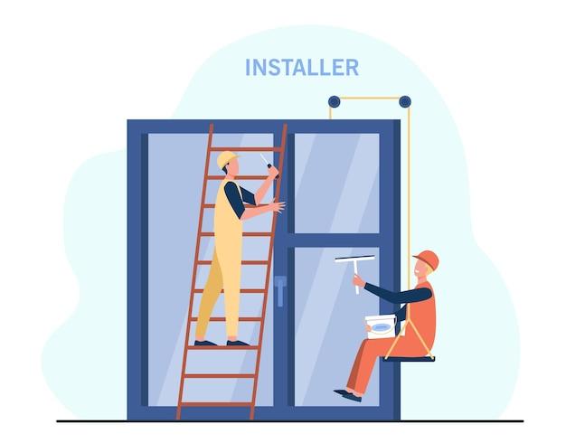 Trabalhadores profissionais instalando janela