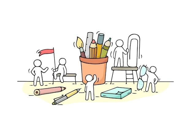 Trabalhar pessoas pequenas com material de escritório