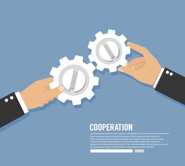 Trabalho de cooperação. mãos com engrenagens. conceito trabalho em equipe
