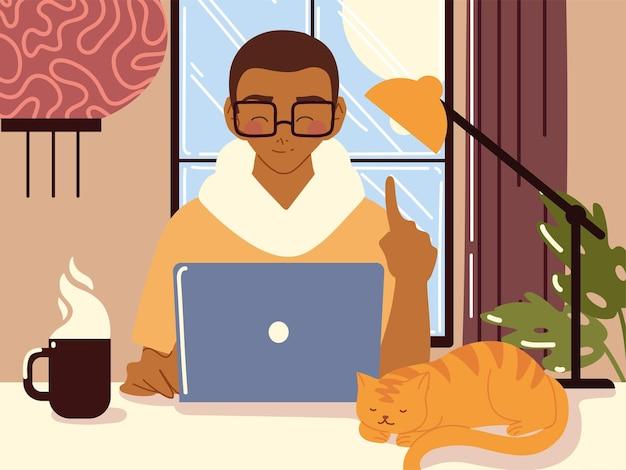 Trabalho em casa, cara usando laptop na mesa com a planta da lâmpada e o gato