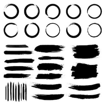 Traçados de pincel áspero de grunge preto.