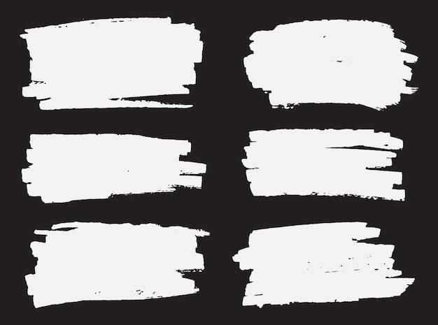 Traçados de pincel branco grunge