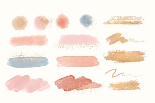 Traçados de pincel pintados à mão com ouro e glitter