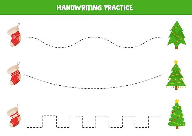 Traçando linhas com árvores de natal e meias. prática de caligrafia para crianças.