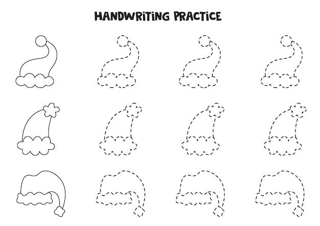 Traçando linhas com bonés de natal bonitos dos desenhos animados. prática da escrita.