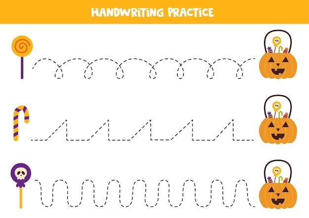 Traçando linhas com doces e abóbora de halloween. prática da escrita.