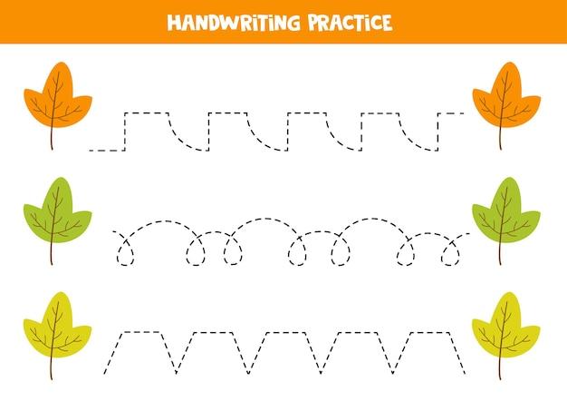 Traçando linhas com folhas de outono. prática da escrita.