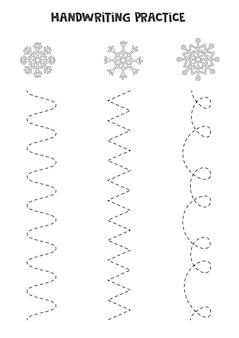 Traçando linhas para crianças com flocos de neve pretos e brancos bonitos. prática de caligrafia para crianças.