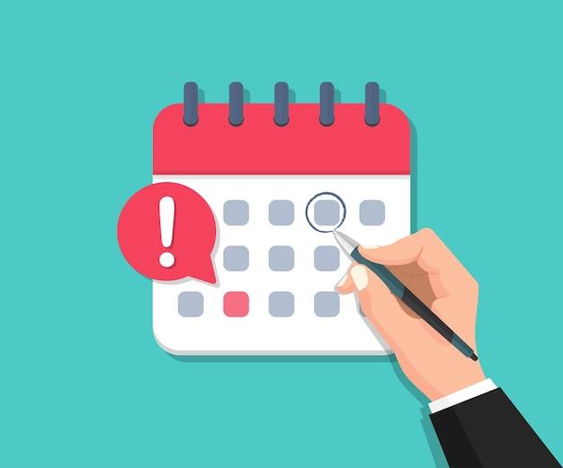 Traçando manualmente a data do calendário com uma caneta. calendário de prazos